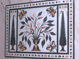 Marquetry panel inside a Palissandro Classic and Pink Quarzite bathroom